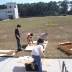 Paul, Phillip, Nathaniel, and Alex working on the bridge.