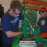 Ryan and Andrew riveting the 2012 robot.