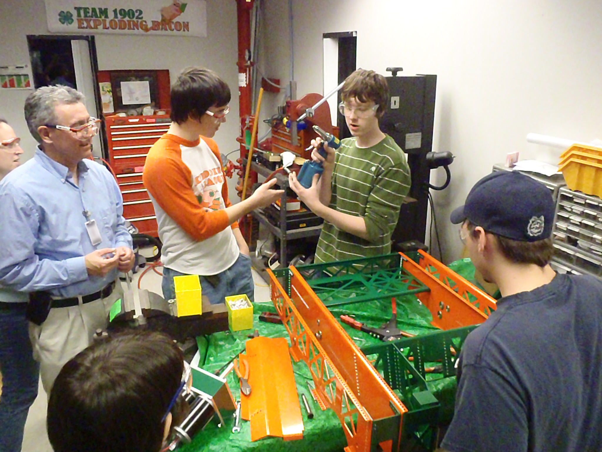Everyone gets to help rivet the robot.  Even the Mentors and parents get to put a few rivets on.