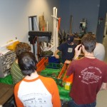 A group of students and mentors working on the 2012 robot.