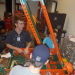 Ryan, Andrew, and Phillip working on the robot.