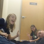 Katie, Sarah, and Zach having fun while working on award submissions.