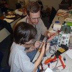 Brian and Phillip soldering.