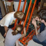 Brendan, Katie and Kris working to get the chain just right.